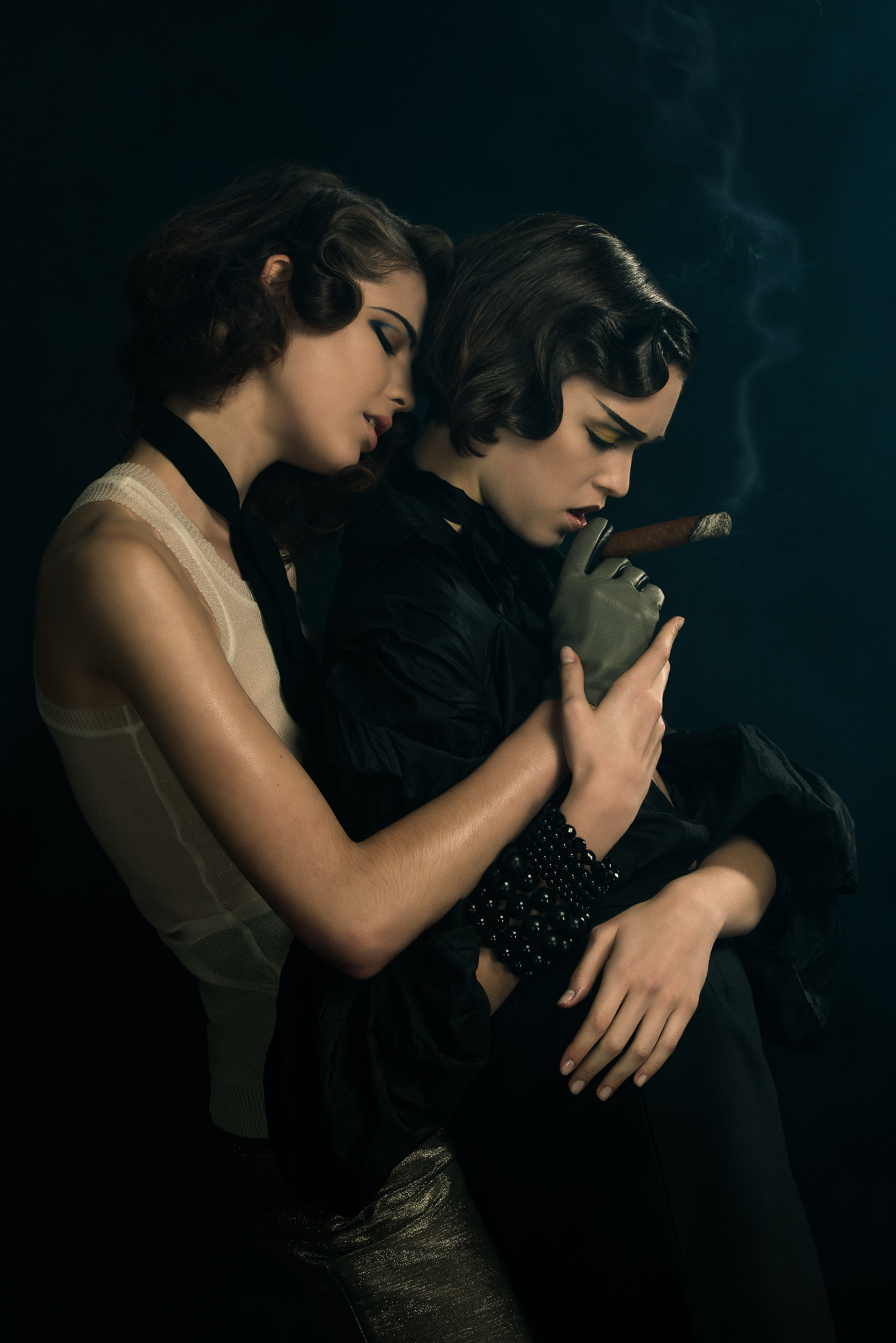 Two models sharing a cigar by Marc Rogoff