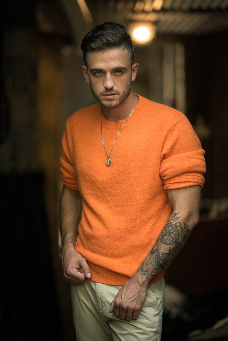 Portrait of male in orange sweater