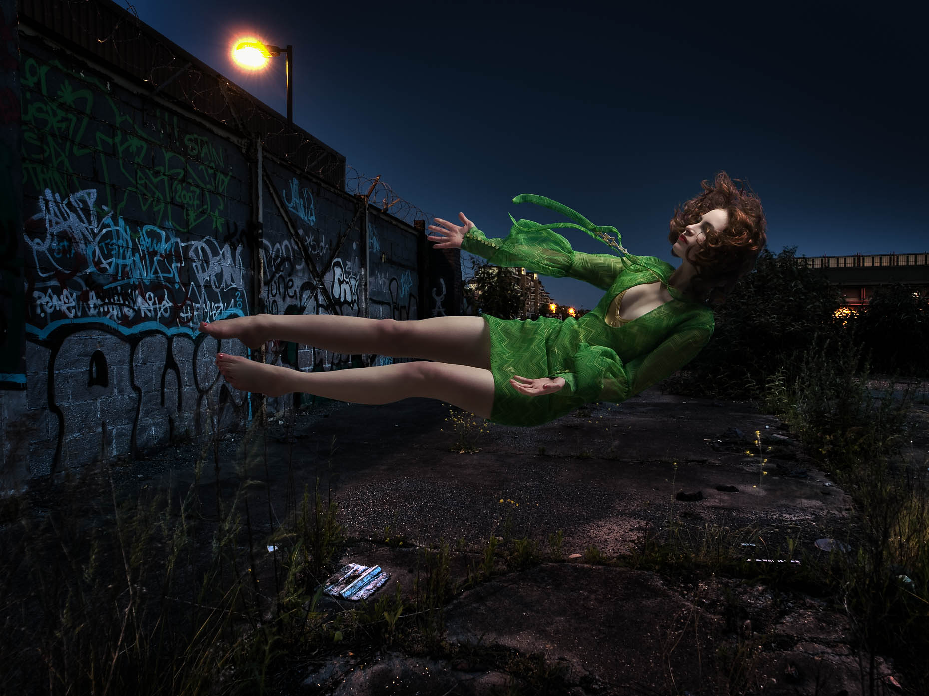 fashion-photograph-of-girl-floating-green-dress